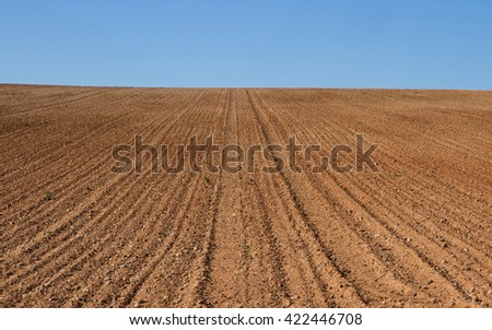 Knoll freshly plowed farmland and prepared for cultivation