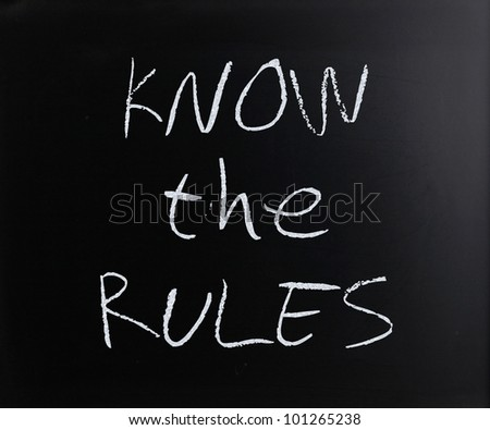 """""""Know the rules"""" handwritten with white chalk on a blackboard. - stock photo"""