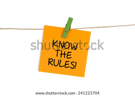 """Know The Rules"" written on Sticky Note - stock photo"