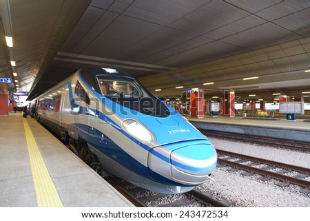 KRAKOW, POLAND - JANUARY 3, 2015: High-speed intercity train on the platform of the train station in Krakow - stock photo