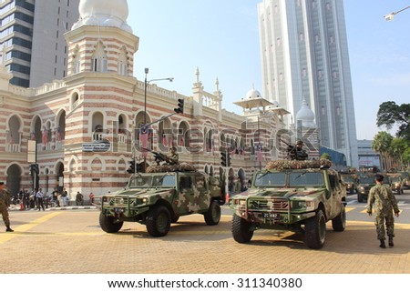 KUALA LUMPUR-Aug 28: Vehicle with 12.7 MM Heavy Machine Gun cruise the road  during the rehearsal for National Day parade on Aug 28,2015 in front Textile Museum ,Dataran Merdeka,Kuala Lumpur,Malaysia - stock photo
