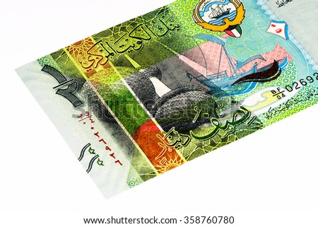 Kuwaiti cash crossword clue