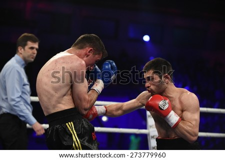 Kyiv, UKRAINE - April 18, 2015 : An unidentified boxers in the ring during fight for ranking points in the Palace of sport, Kiev, Ukraine