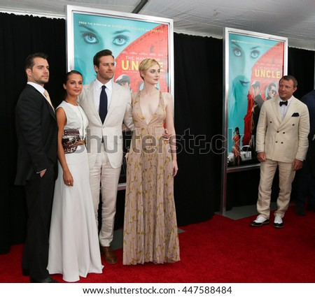 "(L-R) Actors Henry Cavill, Alicia Vikander, Armie Hammer, Elizabeth Debicki and director Guy Ritchie attend ""The Man From U.N.C.L.E."" premiere at Ziegfeld Theatre on August 10, 2015 in New York City. - stock photo"