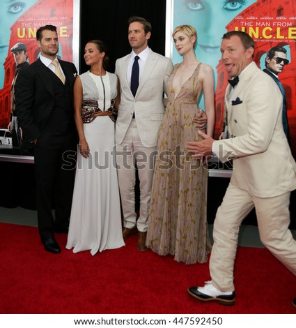 "(L-R) Actors Henry Cavill, Alicia Vikaner, Armie Hammer, Elizabeth Debicki and director Guy Ritchie attend ""The Man From U.N.C.L.E."" premiere at Ziegfeld Theatre on August 10, 2015 in New York City. - stock photo"