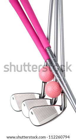 Ladies golf clubs (irons #4, 5, 6) with magenta grips and pink golf balls. Isolated on white. - stock photo