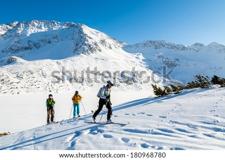 5 LAKES VALLEY, HIGH TATRA MOUNTAINS - FEB 9: skiers walking on fresh snow in 5 lakes valley in winter season on 9th Feb 2014. This area is most popular for ski touring in Poland. - stock photo