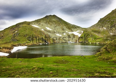 Landscape from Capra Lake and Fagaras mountains in Romania - stock photo