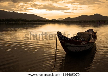 Landscape with boat, mountains clouds and sunset Lang Co bay, Vietnam - stock photo