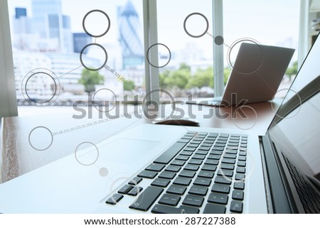 laptop computer is on wooden desk as workplace concept with social network diagram - stock photo