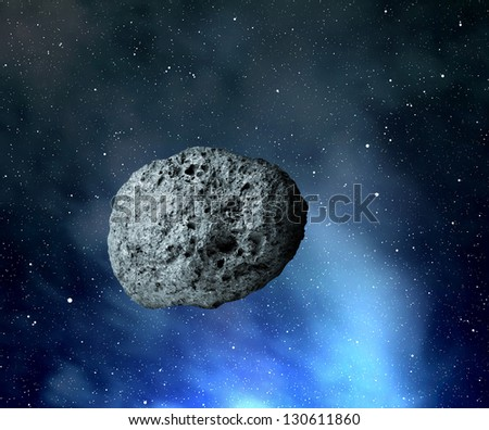large asteroid flying in the universe - stock photo