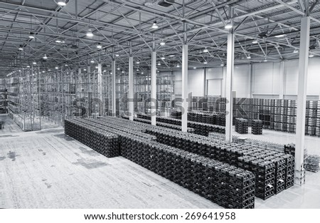 large number of packings with mineral water on finished goods warehouse - stock photo