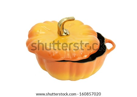 large saucepan in a pumpkin on a white background