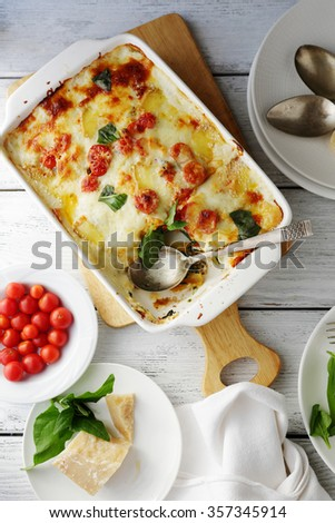 lasagna in baking dish, food top view - stock photo