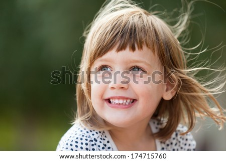 laughing baby girl in summer - stock photo