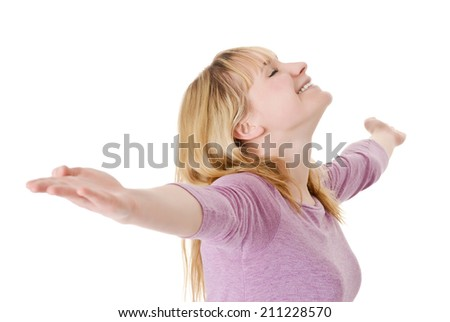 laughing young blond woman rejoicing - stock photo