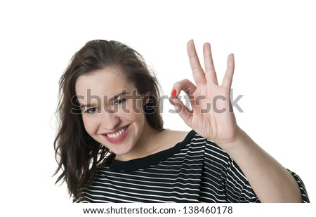 laughing young woman showing ok-sign - stock photo