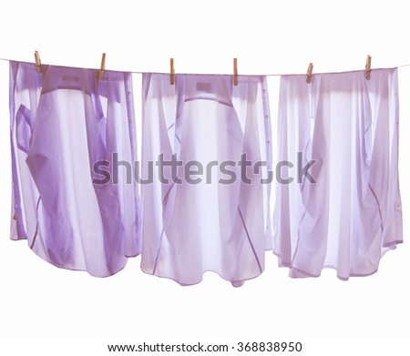 Laundry line of clothes isolated over white background vintage - stock photo