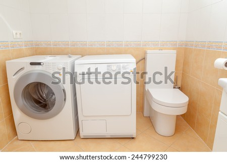 laundry room with modern appliances - stock photo