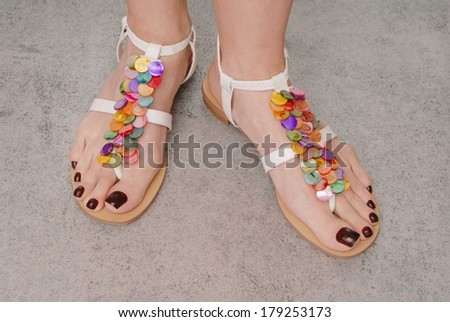 leather sandals are on female feet