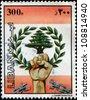 LEBANON - CIRCA 1984: A stamp printed in Lebanon shows Broken chain, hand holding laurel wreath and cedar, circa 1984 - stock photo