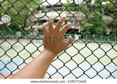 left hand with fence