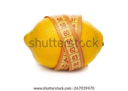 Lemon twisted with tape measure isolated on white - stock photo