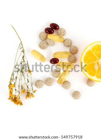 lemons, herbal pills, st,john worth and omega 3 caspules on white background