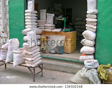 LHASA, TIBET-NOVEMBER 12: flour shop in Barkhor Street. The ancient street is a symbol of Lhasa and a must see place for visitors. November 12, 2004 in Lhasa, Tibet - stock photo
