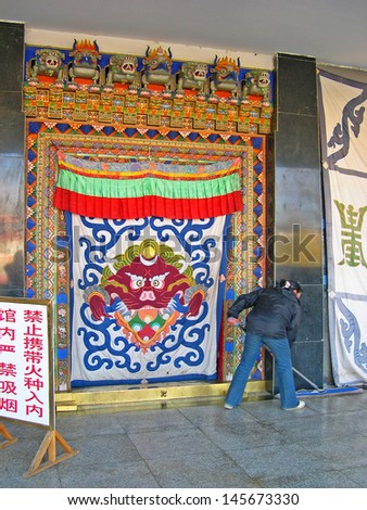 LHASA, TIBET-NOVEMBER 18: lady cleaning the the Tibet Museum entrance hall. This is the official museum of the Tibet Autonomous Region. November 18, 2004 Lhasa, Tibet