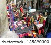 LHASA, TIBET-NOVEMBER 13: locals and tourists shopping in Barkhor Street. The ancient street is a symbol of Lhasa and a must see place for visitors. November 13, 2004 in Lhasa, Tibet - stock photo