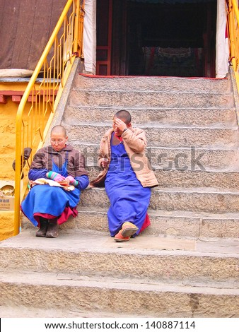 LHASA, TIBET-NOVEMBER 14: nuns relaxing at the Ani Sangkhung Nunnery. The Ani Sangkhung Nunnery is one of the oldest and most active nunneries in Tibet. November 14, 2004 in Lhasa, Tibet