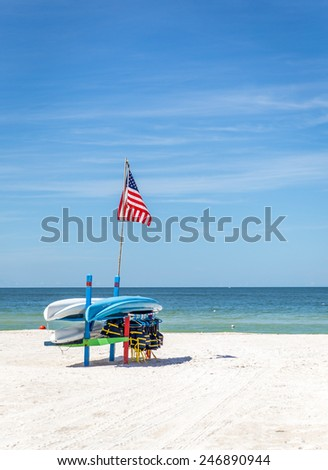 Life jackets and boats on St.Pete beach in Florida, USA  - stock photo