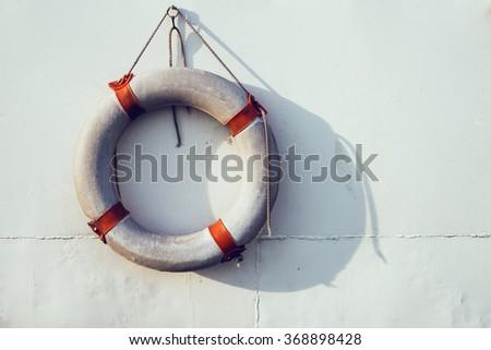 Lifebuoy on the white background. - stock photo