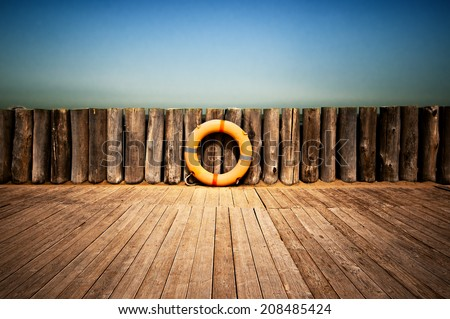 Lifebuoy on wooden wall  - stock photo