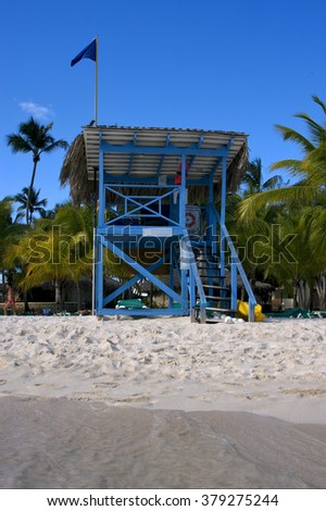 lifeguard chair cabin in republica dominicana  rock stone sky cloud people coastline and summer