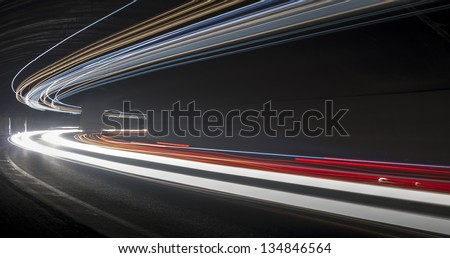 light trails in the tunnel. Art image . Long exposure photo taken in a tunnel below Veliko Tarnovo