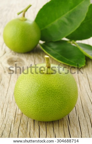 lime fruit on wooden background