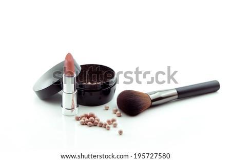 lipstick,bronzing pearls powder  and makeup brush   - stock photo