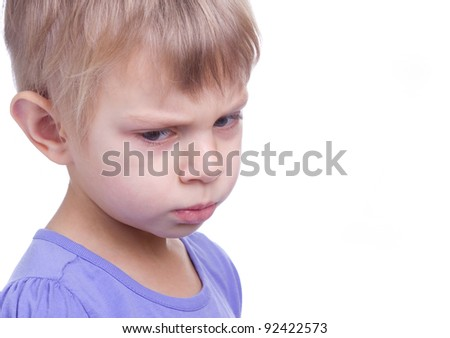little blonde girl with sad eyes on white background