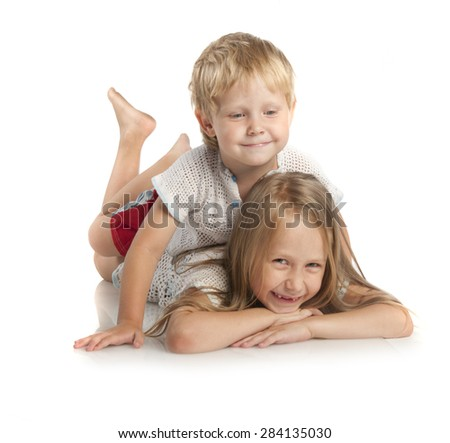 Little boy and girl lying on floor isolated on white background