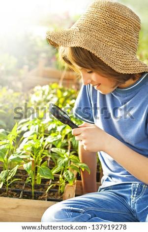 little boy explores the nature - stock photo
