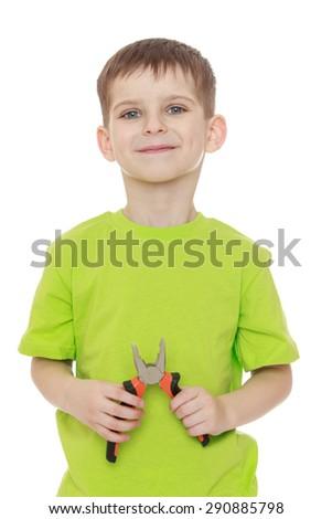 Little boy green t-shirt holding a pair of pliers- isolated on white background - stock photo