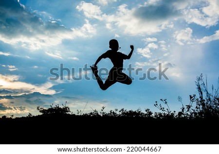 little boy jumping to sky and having happy time, Silhouette concept
