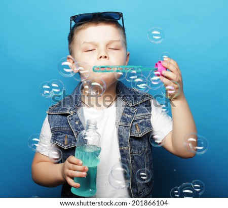 little boy with soap bubbles - stock photo