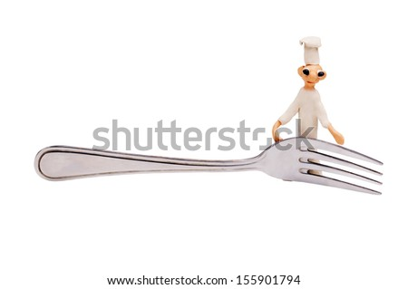 little cheerful chef made from clay and fork