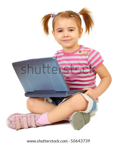 Little funny girl with laptop on white background