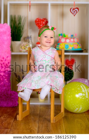 little girl birthday with colored balloons in the bright room  laughing  - stock photo