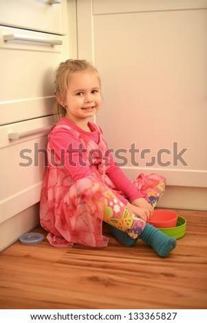 Little girl drinking juice at home