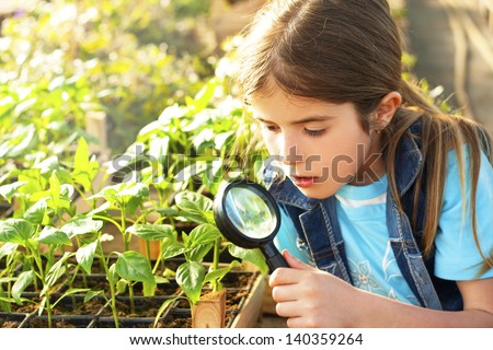 little girl explores the nature - stock photo